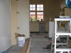 Standing in the new french doors, looking back through the dining nook to the new kitchen work area