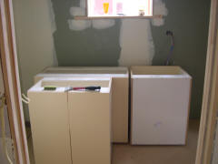 The new laundry going in where the old kitchen bench was