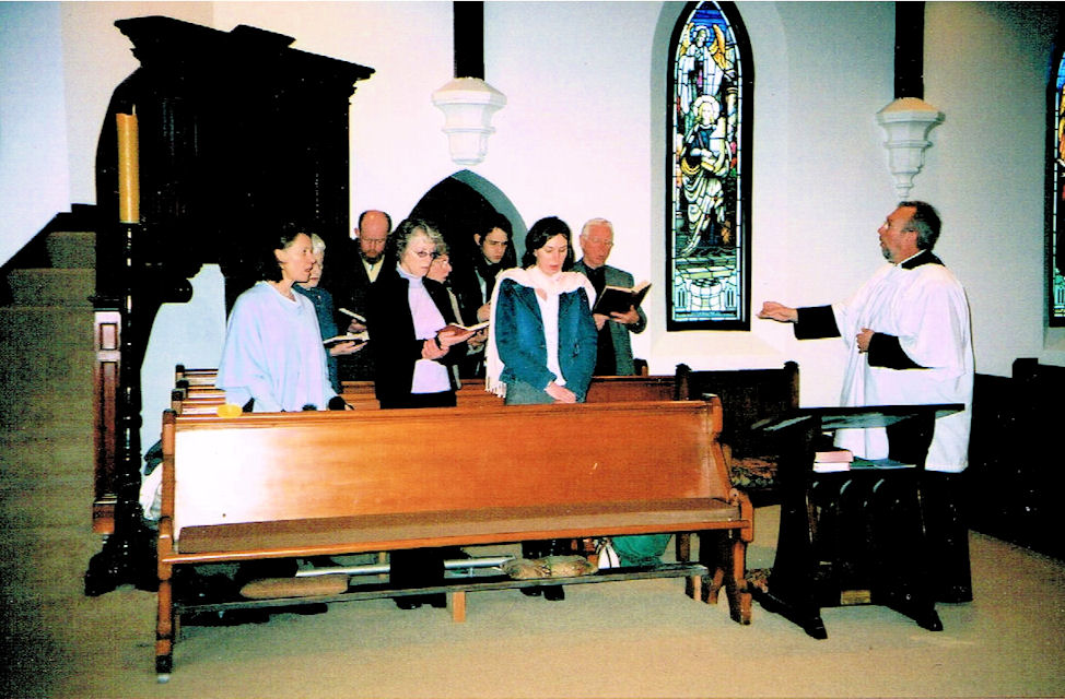 David Hoskins conducts a group of singers shortly after his appointment